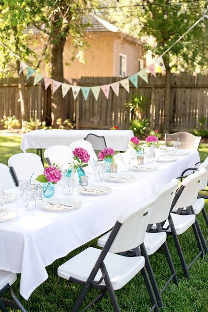 A Backyard Birthday Dinner Party Using Pink Hydrangeas Blue Canning Jars And Polka Dots