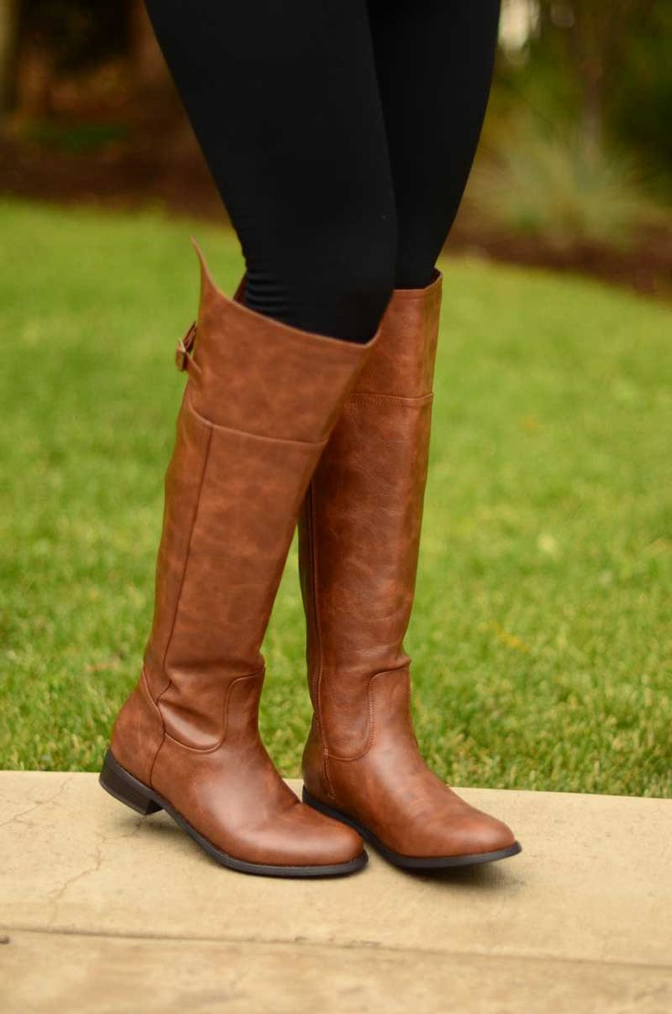 Description We cannot get over these boots. They go all the way up to your knee, have a slit on the back as well as a buckle, are a lovely shade of tan (so versatile) AND are super sturdy! These beaut