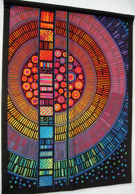 """A great reverse-applique """"mola"""" quilt by Fumiko Nakayama, photographed at Japan Quilt Festival by Be*mused, on her flickr stream  could be a tempera batik idea"""