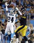 Pittsburgh Steelers at Carolina Panthers - 8/29/2013 - W 25-10 Josh Norman of the Carolina Panthers reaches up to catch a ball against Landry Jones of the Pittsburgh Steelers and the rest of the team at Bank of America Stadium in Charlotte, North Carolina.