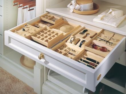 To really make your closet resemble a high-end boutique, give each piece of jewelry a place of its own. Jewelry inserts feature separate compartments for rings, necklaces, bracelets and any other small trinket that may need storing.