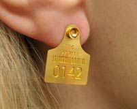 Ear Tag for humans! With its own unique ID number. So weird! I love this concept!