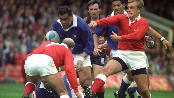 1991-Western Samoa captain Peter Fatialofa drives into Wales' Richie Collins