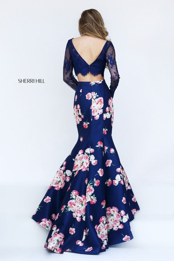 Sherri Hill 50488 long sleeve lace crop top mermaid gown with a fun satin print skirt.
