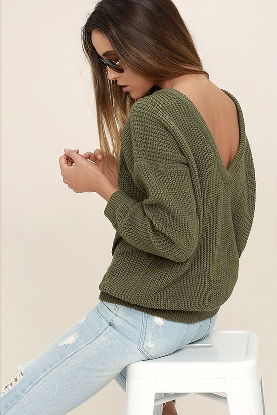 Lulus Exclusive! When your adventures include a light breeze, make sure the Island Ferry Olive Green Sweater comes along for the ride! Medium-weight knit begins at a rounded neckline, then travels to a trendy, low V-back. Wide-cut bodice and loose long sleeves taper slightly to ribbed knit hems.