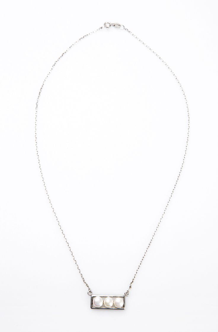 Rectangular Necklace by Petra Tou Romiou. Necklace with rectangular shape features 3 pearls on it. Crafted with stainless steel in white color and has clasp on it.  http://www.zocko.com/z/JJjUH
