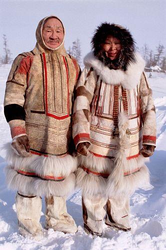 Nadiya Asyandu (right), a Nganasan woman in traditional dress, poses with elder Saibore Momde. Taymyr, Northern Siberia, Russia