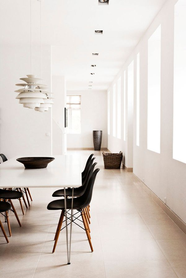 Poul Henningsen for Louis Poulsen lights paired with classic black Eames side chairs on walnut dowel legs. When can I come for dinner?
