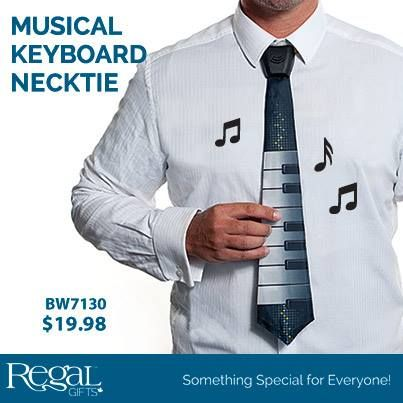"""MUSICAL KEYBOARD NECKTIE  Plays eight electronic notes so that you can showcase your favourite tune while attending the next party! Speaker in the plastic knot with 25"""" quick release closure neck cord for safety; operates on two included button batteries. 18""""L"""
