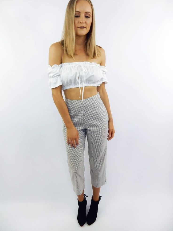The Check Cropped Trousers feature a check print throughout, high waist, and cropped length. Trousers have been pinned on Bec to show correct fit.