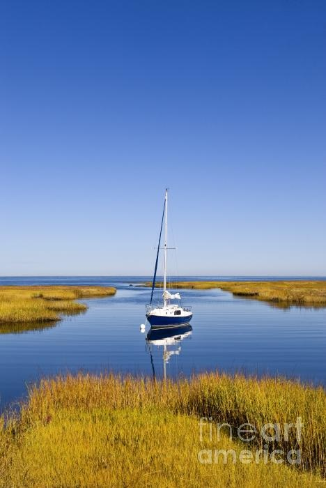 Sailboat in a salt marsh in Cape Cod Bay, Cape Cod, Massachusettes; photo by John Greim
