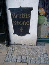 The Brutus Stone. situated in Fore Street, Totnes, Devon, England. According to legend this is the stone that Brutus of Troy stepped on from his ship, as he did so he was supposed to have said 'Here I stand and here I rest. And this town shall be called Totnes'