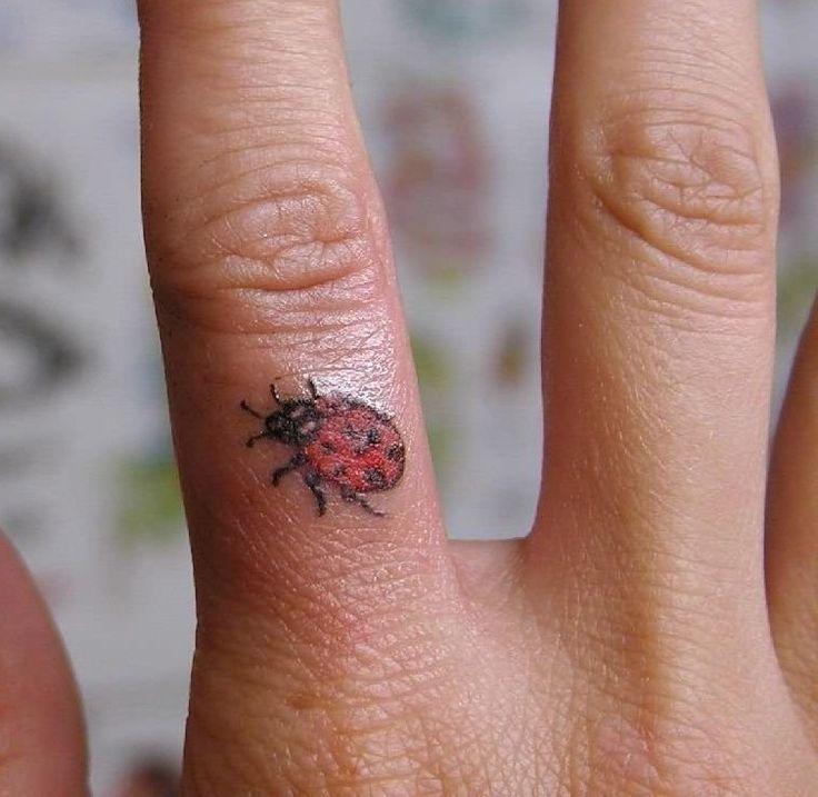 tiny Ladybug finger Tattoo