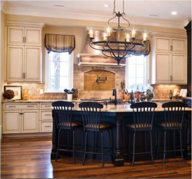 floor color, cream cabinets, black island..Love! Love the chandelier too!!