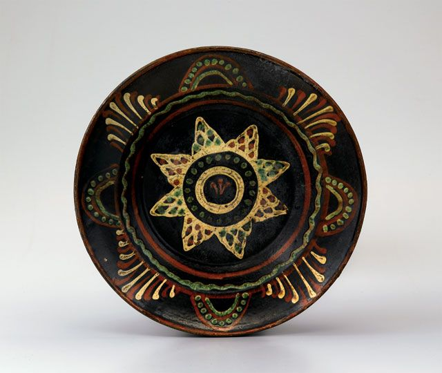 "Dish, Alamance County, North Carolina, 1790-1820. Lead-glazed earthenware. D. 10"". (Old Salem Museums & Gardens.) --- Art in Clay: Masterworks of North Carolina Earthenware by Old Salem Museums and Gardens, Chipstone Foundation, and Caxambas Foundation."