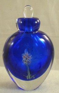 MURANO COBALT BLUE PERFUME BOTTLE ENCASED FLOWER  http://www.ebay.com/itm/MURANO-COBALT-BLUE-PERFUME-BOTTLE-ENCASED-FLOWER-/370600802318?pt=LH_DefaultDomain_0=item564987780e#ht_5132wt_754