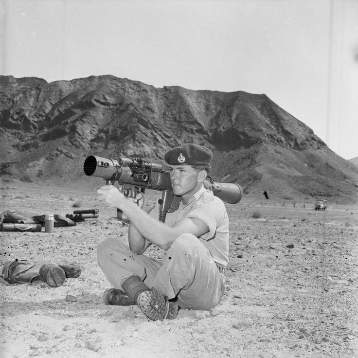 ROYAL MARINES DEMONSTRATE ARMY'S NEW ANTI-TANK GUN. AUGUST 1963, LITTLE ADEN, ROYAL MARINES OF 45 COMMANDO WERE DEMONSTRATING (ON BEHALF OF THE WAR OFFICE) TO SENIOR OFFICERS OF MIDDLE EAST COMMAND, ONE OF THE BRITISH ARMY'S NEW ANTI-TANK WEAPONS, THE 84MM PLATOON ANTI-TANK GUN (CARL GUSTAV). SWEDISH DESIGNED, THE CARL GUSTAV HAS GREATER ACCURACY, FASTER RATE OF FIRE AND MORE RELIABLE DISCHARGE THAN THE 3.5 INCH ROCKET LAUNCHER.