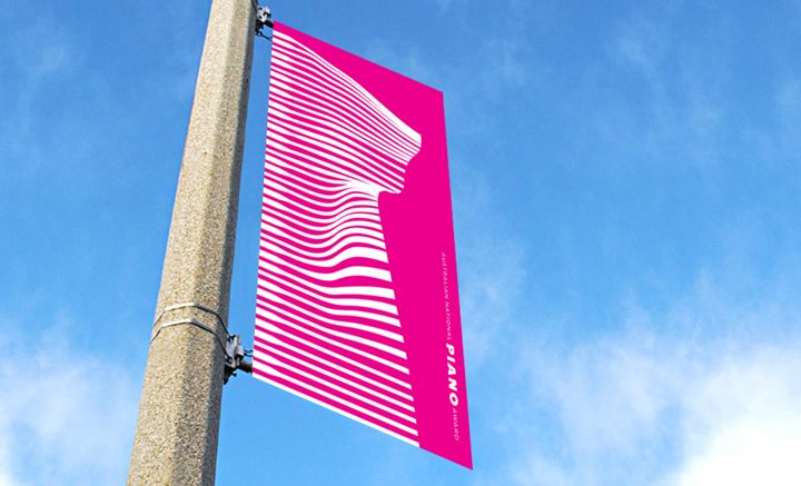 Australian National Piano Awards 2016  Being an ongoing event, the custom design challenge was to project energy and a sense of the contemporary into the National Piano Awards. The abstraction of the piano keys (thicker on the left indicating the black keys) into a ribbon form represented a graphically compelling and striking custom type identity, particularly in the street banners which are a large part of the media presence of the 2016 event.