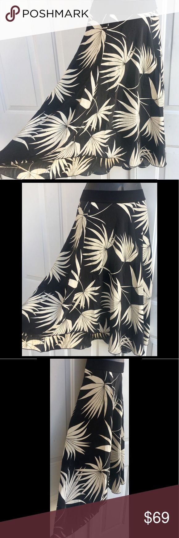 Tommy Bahama 100% Silk Tropical Floral Skirt M L Tommy Bahama. Black and White Tropical Floral Print Hi Lo Swing Flowy Skirt. 100% Silk. Elasticized waistband. Size tag reads Medium. Would fit a large as well as the waist band is stretchy. This skirt makes you want to twirl! So Flowy and so silky soft! Brand New Tommy Bahama Skirts High Low