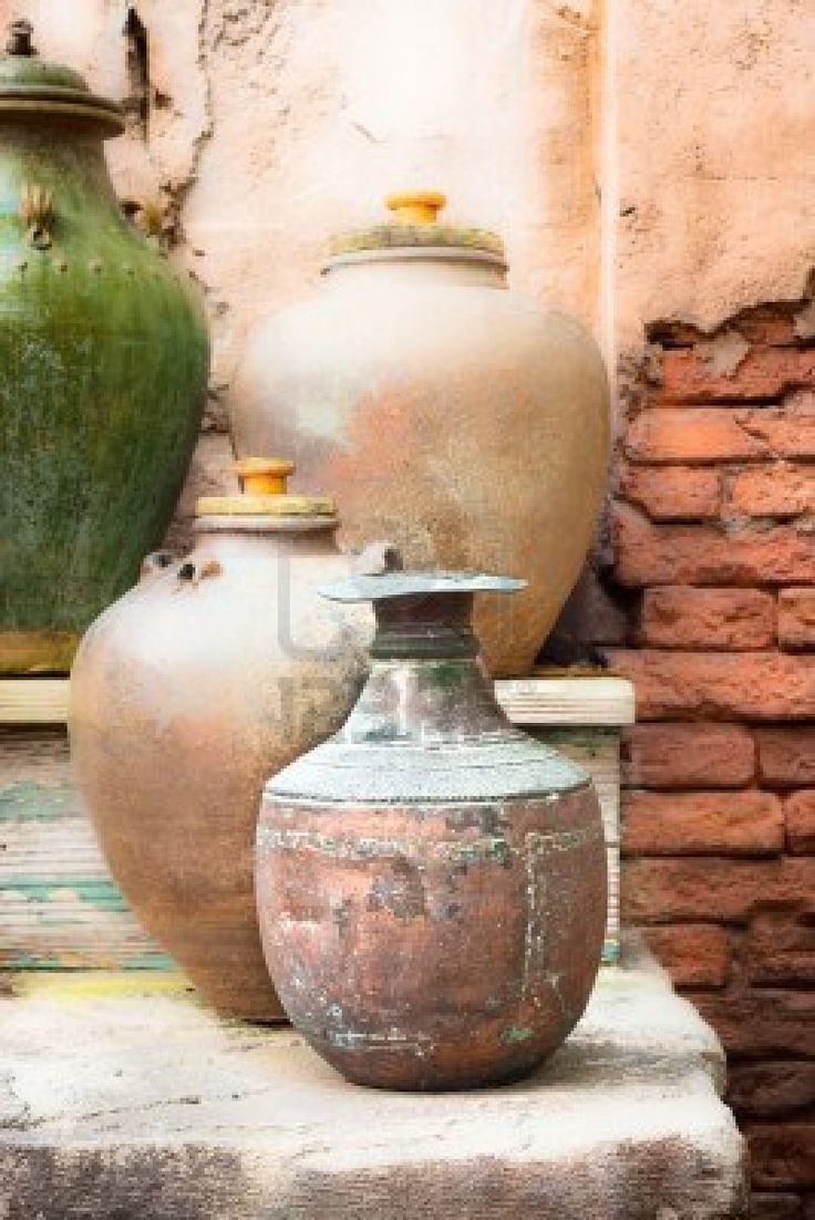 Collection of vintage urns and pots in a courtyard