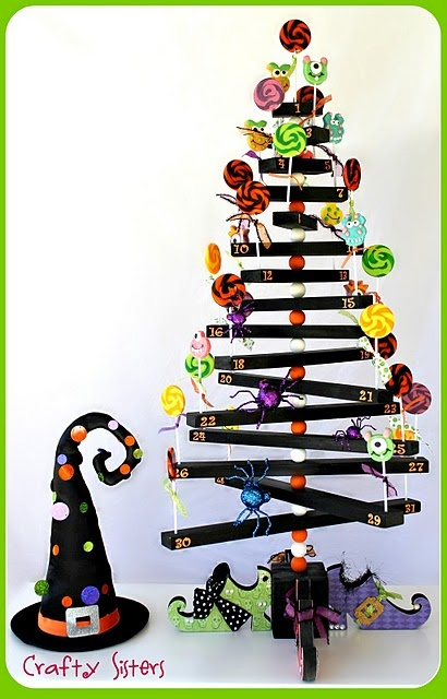 How to make a Halloween lollipop tree http://craftysisters-nc.blogspot.com/2011/10/halloween-lollipop-tree-tutorial-wyltc.html