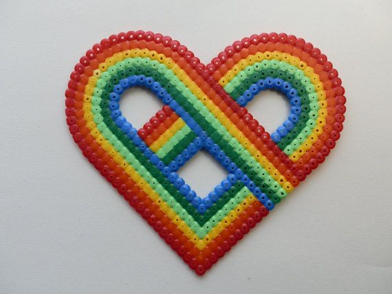 Rainbow heart hama beads by FlozosCrafts. Might be able to convert to a crochet pattern.