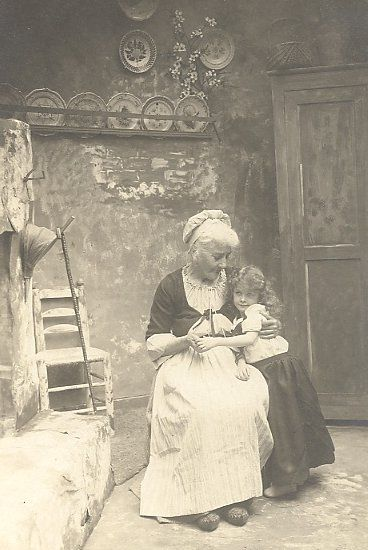1905 Grandma and her granddaughter. Makes one think of Little Red Riding Hood, Hansel and Gretel or other Grimm's fairy-tales!