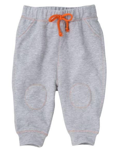 A great choice for everyday wear these trackpants have a relaxed fit with a dropped crotch, elasticated waistband and an orange drawstring. They also have knee patches and side pockets.