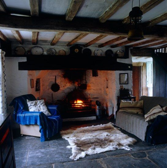 A large inglenook fireplace dominates one end of the living room.