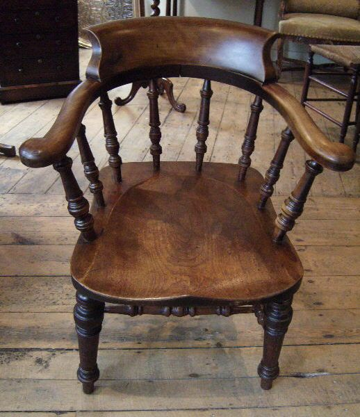 thinking of refinishing our kitchen table and chairs and staining them darker, like this captains chair. hopefully a more updated look.