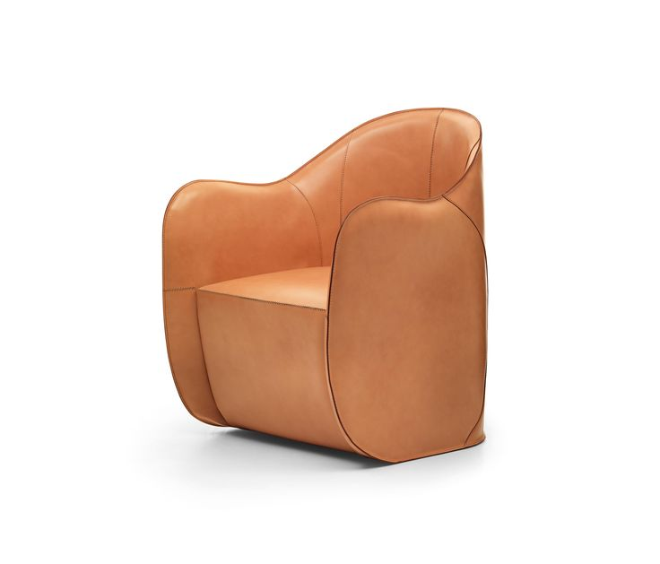 In this armchair and pouf the cow-hide is both surface and structure. Like in an insect's exoskeleton there is no internal support structure. In both products the polyurethane body is covered with cow-hide panels that once sewn together become structural. The material of the shells and their surfaces are rich but the objects are extremely light. The slight tilt of the armchair's base and the flexibility of the armrests allow for a seating style that follows the movements of the body…