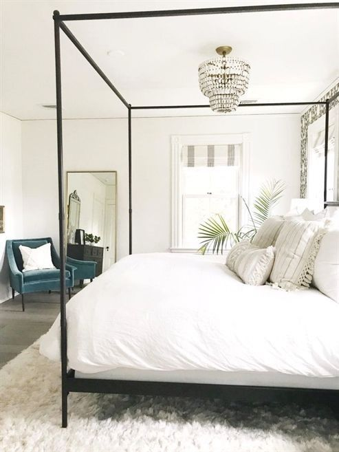 neutral bedroom decor with modern four poster bed