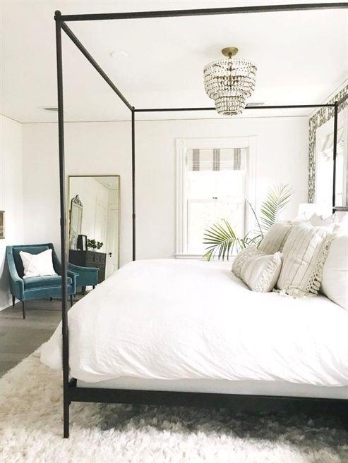 neutral bedroom decor with modern four poster bed master bedroom rh pinterest com