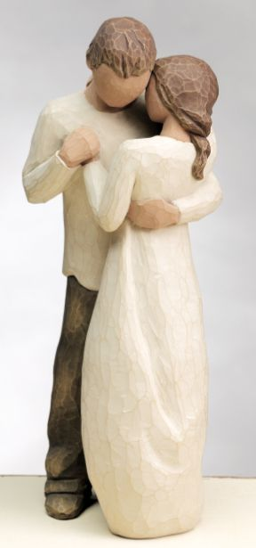 Willow Tree figurines.  Wouldn't Willow tree make lovely cake toppers?  They should- and with custom hair and skin colors. :)