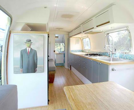 Vintage Airstream renovated into this gorgeous looking caravan love the layout and open space
