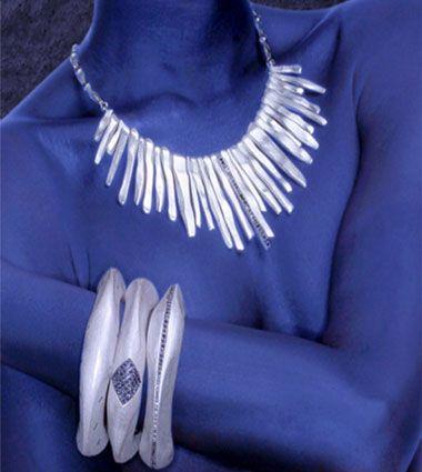 Metallic silver contrasting with eerie blue . Coomi 47 AG in Harper's Bazaar