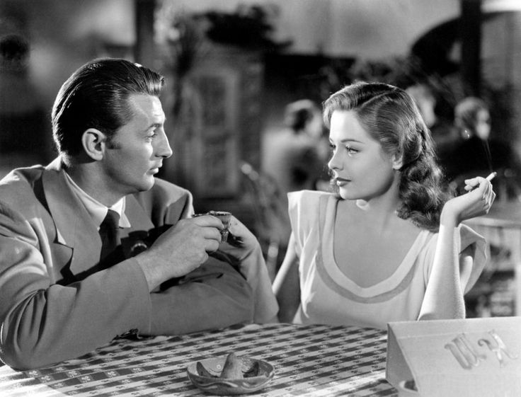 """hoy descubrí una nueva obra de Jacques Tourneur. """"Out of the Past"""" de 1947.  Robert Mitchum, Jane Greer pero principalmente Kirk Douglas, genial como mafioso cool. Y ojitos se ponen, pero esta imagen es promocional porque en ningún momento de esa escena esta pareja brinda...  Yo sí lo hago, por el buen cine. Cheers!"""