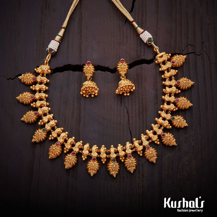 Elegantly Crafted #antique #necklace studded with #ruby stones and plated with #gold polish #kushalsfashionjewellery