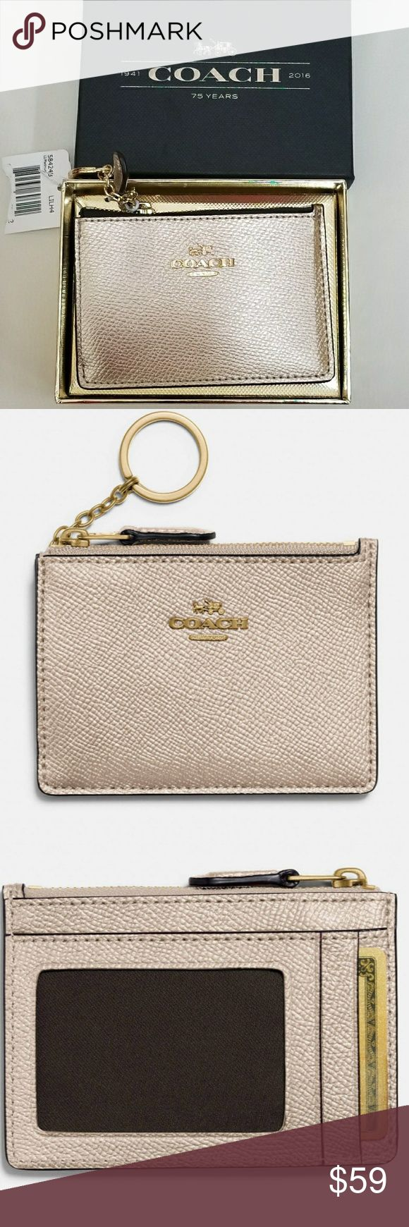 NWT Coach mini skinny ID case Women's skinny wallet New with tag Still in box Beautiful blush pink metallic Coach logo in gold  Perfect size to put quarters for laundry, license, credit card and cash Can be attached to your keys Coach Bags Wallets