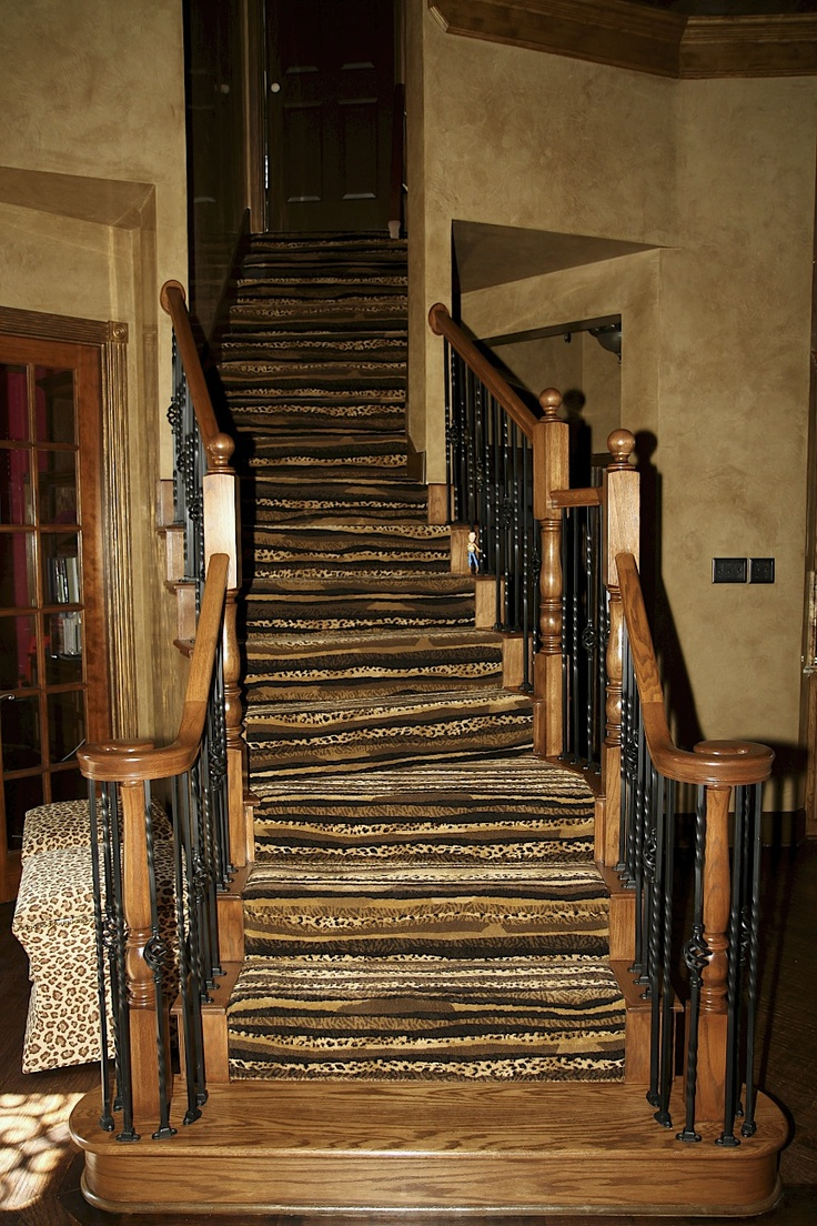 Venetian Plaster walls custom color. Stairway was refinished, black iron spindles repainted, wood refinished and accented leopard stripped carpet.