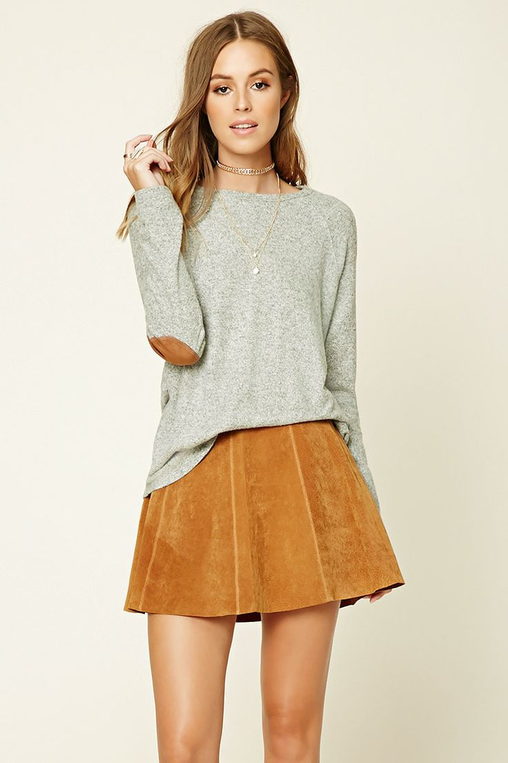 A soft marled knit sweater featuring faux suede elbow patches, a round neckline, and long raglan sleeves.