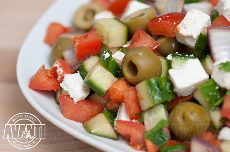 Greek Salad (Olives, tomato, pepper and cheese in spicy oil)