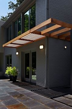 Awnings can come in all different shapes, styles and materials. This is a beautiful, simple look.