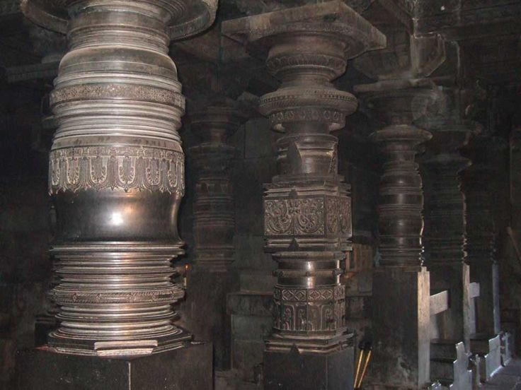 Lathe-turned pillars, made from a soapstone which hardens on contact with the air. The vertical lathes were elephant-powered.