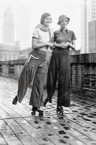 """1933 Theresa Townsend and Joan Hamilton - Manhattan, New York - The jersey """"sylo-pyjamas"""" in red, white and blue during a period of skating on the roof of Roosevelt Hotel - Photo by Otto Bettmann"""