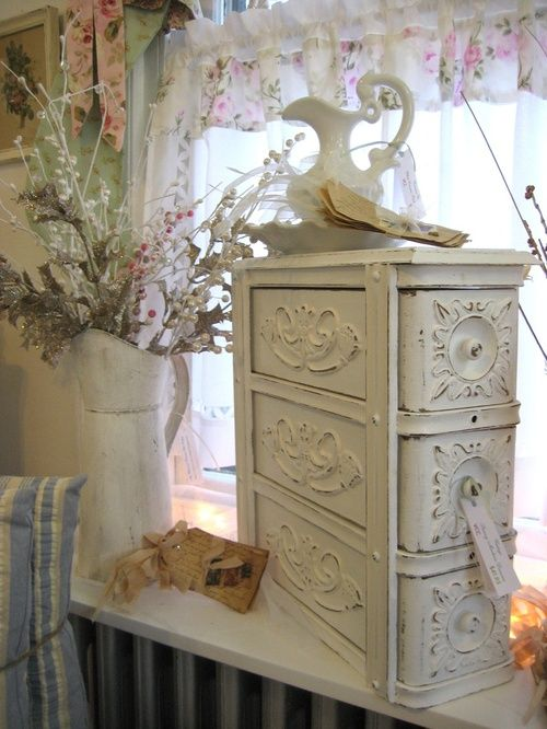 Romantic Cottage - how cute is this?  These would be the drawers from an old treddle sewing machine table.