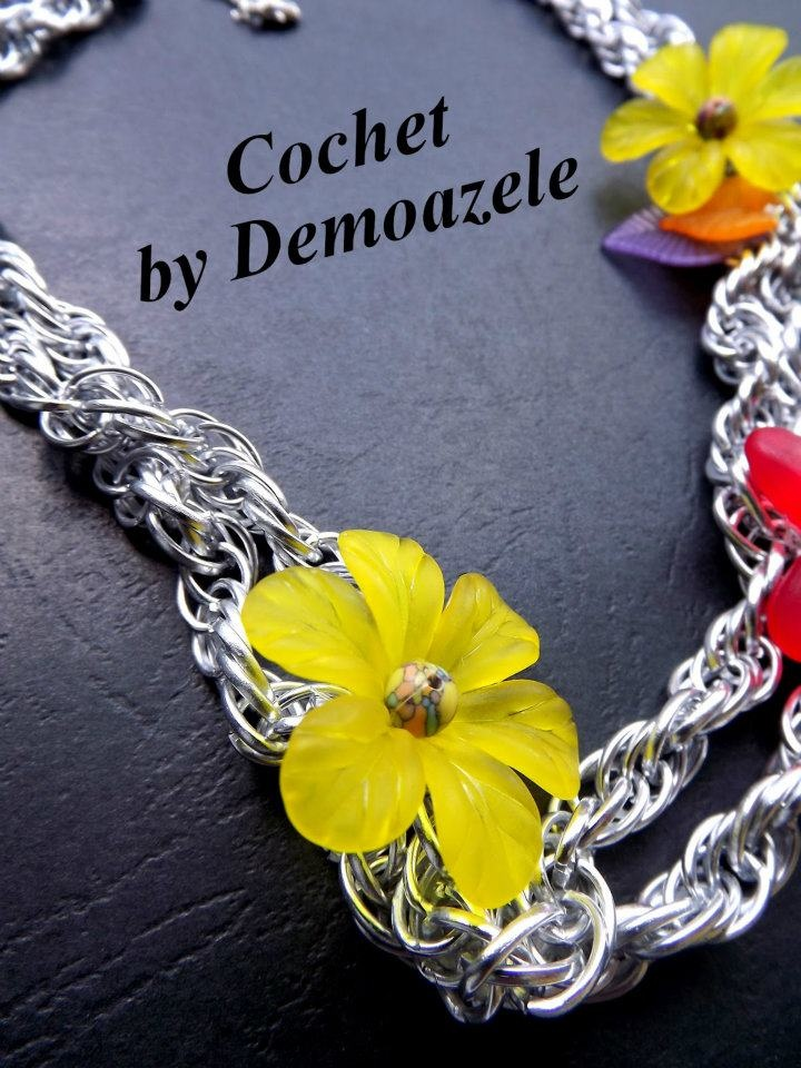 Silver chain necklace made, accessorized with acrylic beads in various shades.