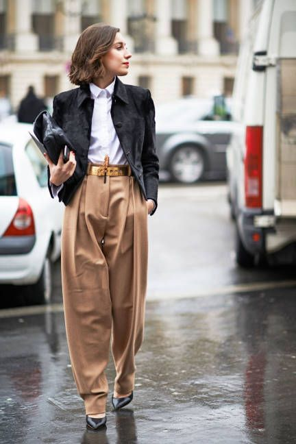 Paris Fashion Week Fall 2013 Street Style - She looks elegant despite the baggy slacks! Love the belt!