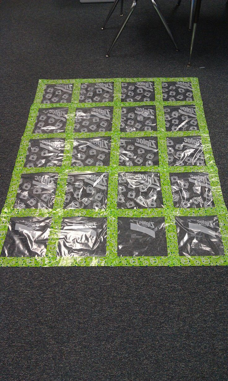 "Gallon Ziploc bags, Duck tape, and lots of patience... An art quilt! Students' work slides in the back. You won't see where it says Ziploc because that is on the back side!"" This is a fantastic idea."