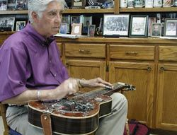 The Treasured Traditions of Louisiana Music By Ben Sandmel; Laymon Godwin playing a dobro. Photo: Susan Roach. http://www.louisianafolklife.org/LT/Articles_Essays/treas_trad_la_music.html